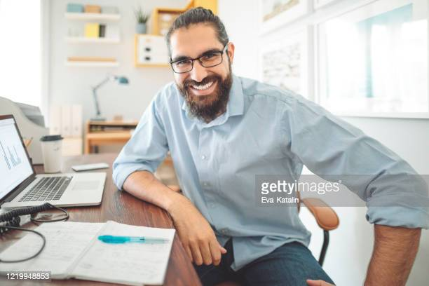 working at home - only mid adult men stock pictures, royalty-free photos & images