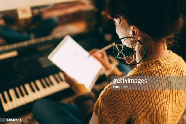 working at home while isolated - keyboard player stock pictures, royalty-free photos & images