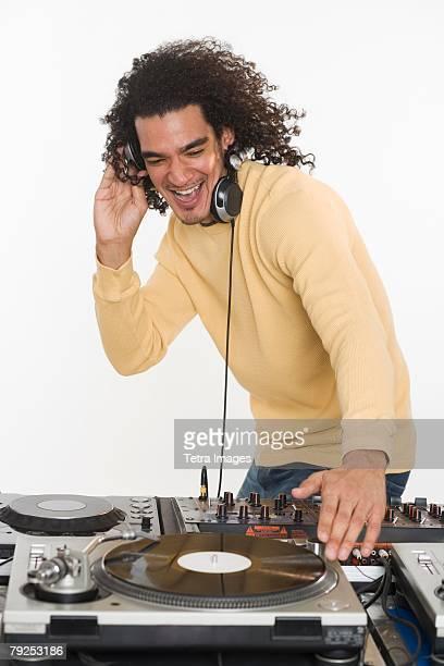 dj working at music mixing board - ラジオdj ストックフォトと画像