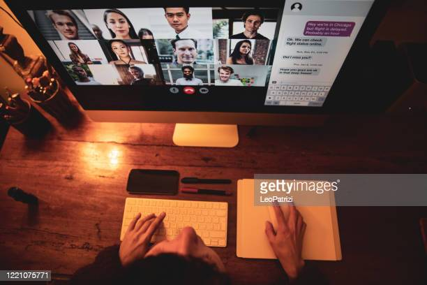 working at night during lockdown period. woman reading news about covid-19 and have a video conference - video still stock pictures, royalty-free photos & images