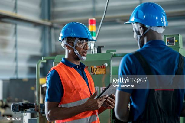working at safety first.  manager and technical working morning meeting in workshop before start working at production line in a factory. - may day international workers day stock pictures, royalty-free photos & images
