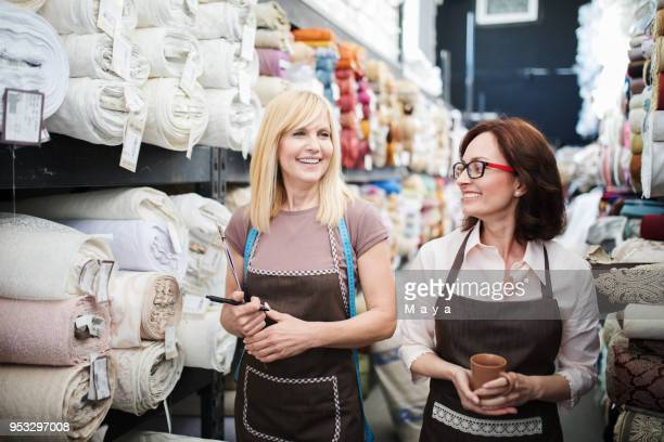 working at textil warehouse - textile industry stock pictures, royalty-free photos & images