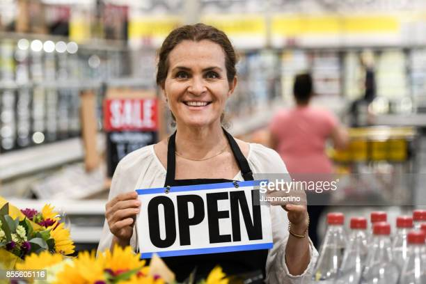 working at the supermarket - convenience store stock photos and pictures