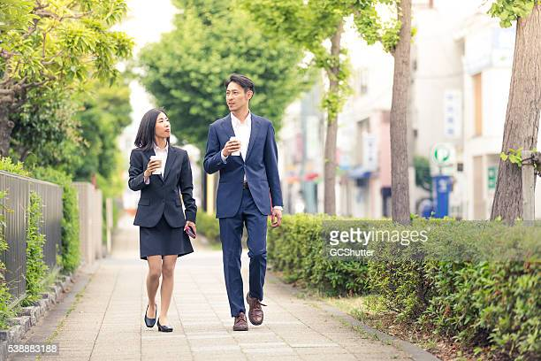 working before even the actual office work starts - heterosexual couple stock pictures, royalty-free photos & images