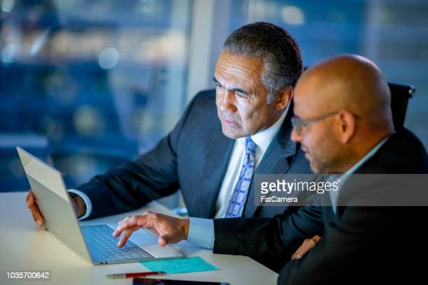 working businessmen - fatcamera stock pictures, royalty-free photos & images