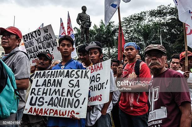 Working class Filipinos gather at the Liwasang Bonifacio as Militant groups mark the 150th birthday of Filipino patriot Andres Bonifacio by holding...