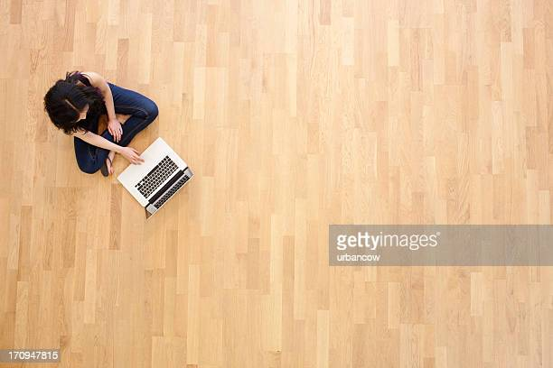 working cross-legged - wooden floor stock pictures, royalty-free photos & images