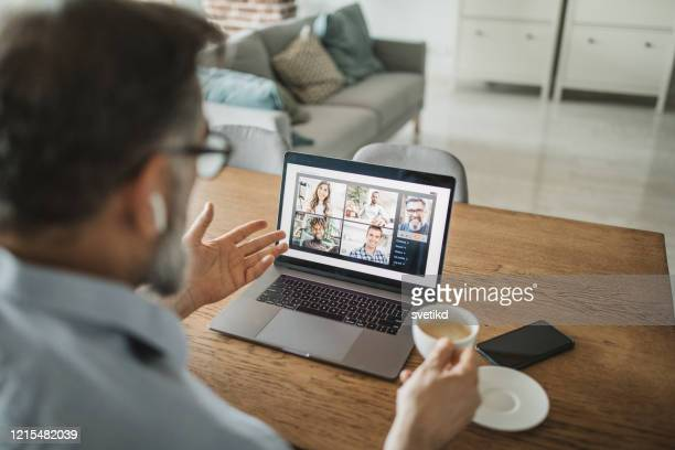 working during isolation period - conference call stock pictures, royalty-free photos & images