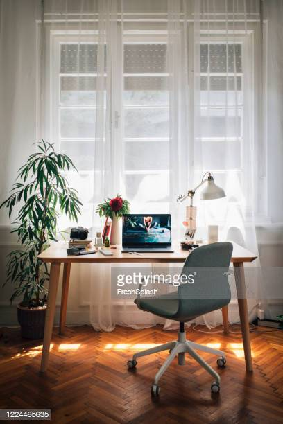 working from home: an improvised home office of a businesswoman, laptop on the desk - laptop on desk stock pictures, royalty-free photos & images