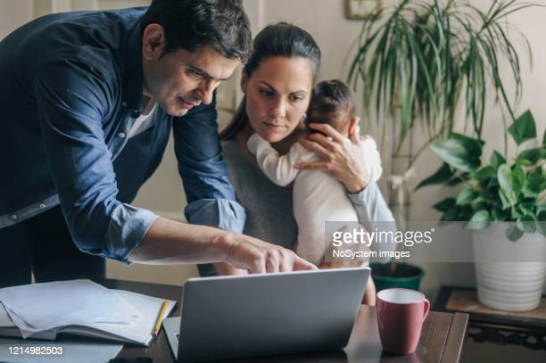 working from home due to covid-19 pandemic - emergencies and disasters stock pictures, royalty-free photos & images