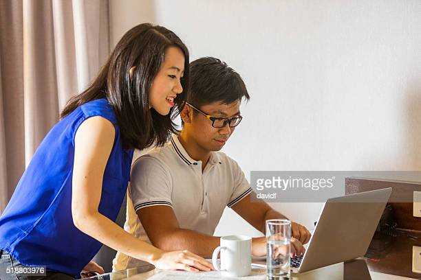 Working From Home Office Happy Young Asian Couple