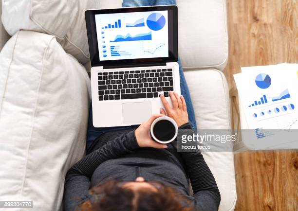 working from home - over the shoulder view stock pictures, royalty-free photos & images
