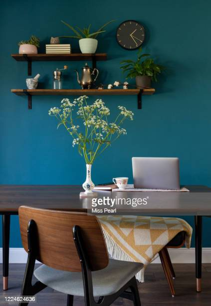 working from home with laptop at kitchen table - decor stock pictures, royalty-free photos & images