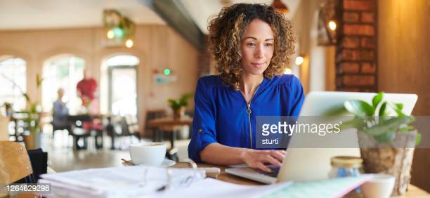 working from the cafe - using laptop stock pictures, royalty-free photos & images