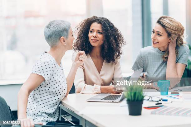 working girs - gossip stock pictures, royalty-free photos & images