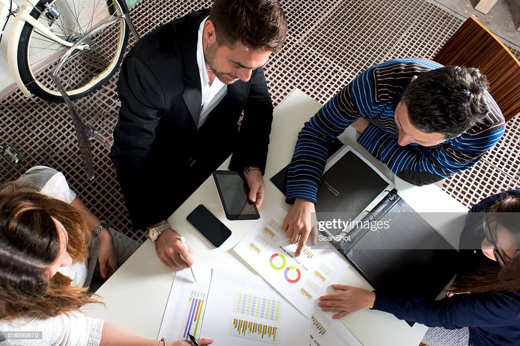 Working Group analyzing Reports : Stock Photo