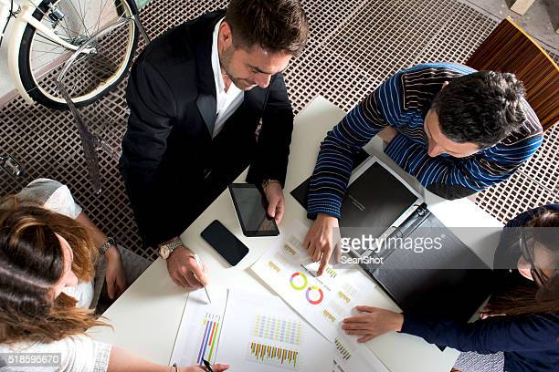 working group analyzing reports - wealth stock pictures, royalty-free photos & images