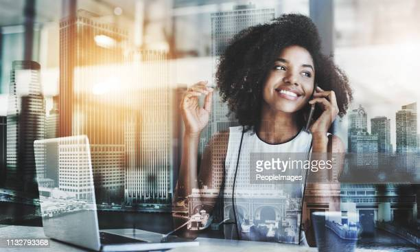 working hard for what she wants - telecommunications equipment stock pictures, royalty-free photos & images