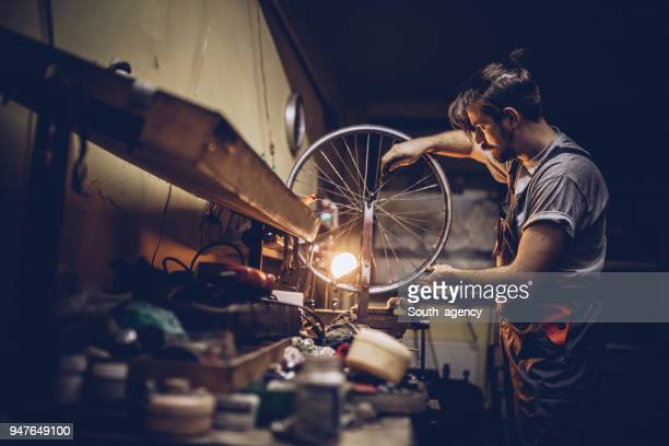 working hard in repair shop - bicycle shop stock pictures, royalty-free photos & images