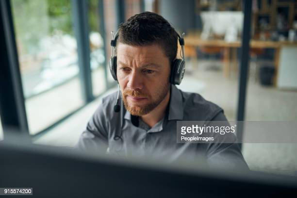 working hard to resolve all issues for his customers - communication occupation stock pictures, royalty-free photos & images
