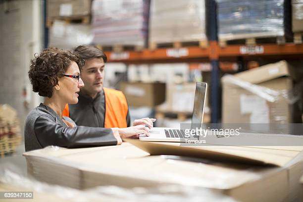 working hard. wearhouse workers. - heavy industry stock photos and pictures