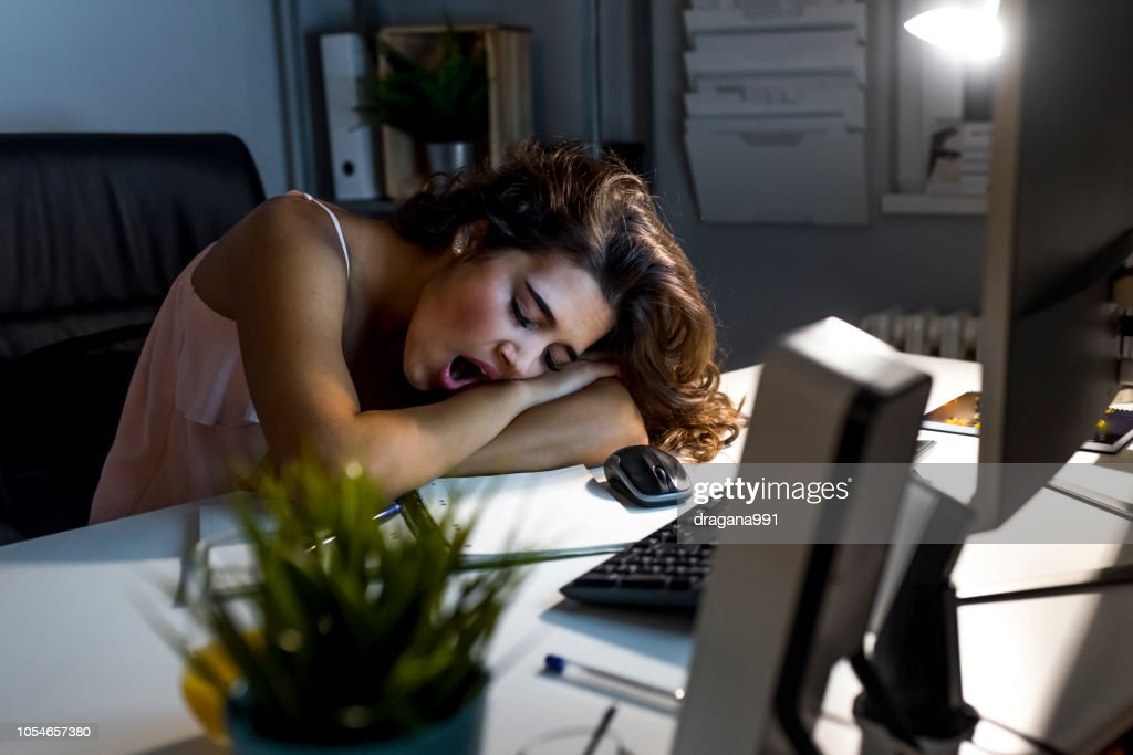 Working hard women fall sleep at office at night : Foto de stock