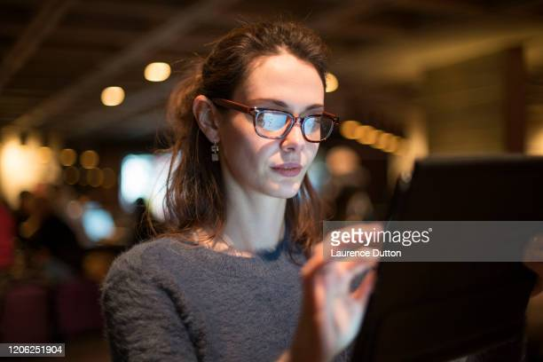 working in a bar - hot desking stock pictures, royalty-free photos & images