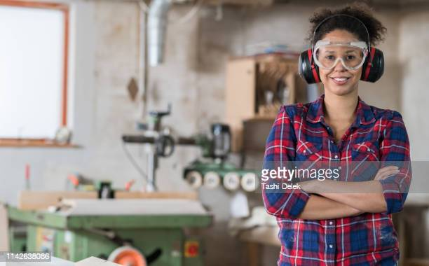 working in carpentry - ear protection stock pictures, royalty-free photos & images