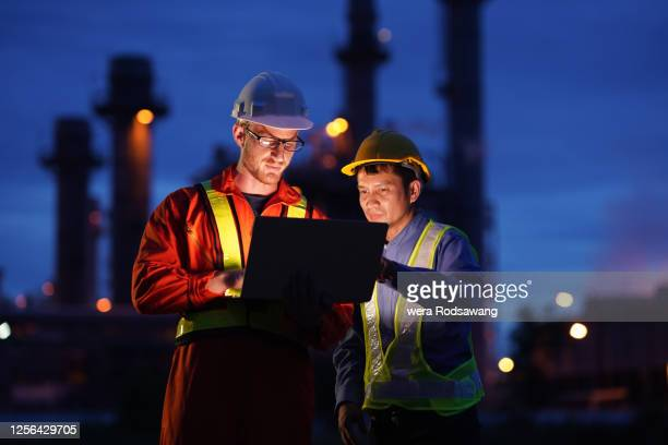 working in construction site at natural gas power plant - manufacturing stock pictures, royalty-free photos & images