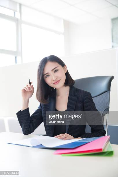 working in office - accounting stock photos and pictures