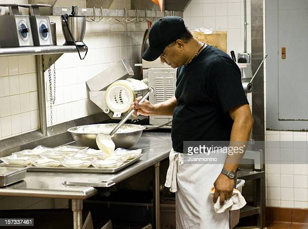working in the kitchen - refugee stock pictures, royalty-free photos & images