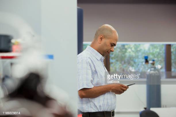 working in the lab - nepalese ethnicity stock pictures, royalty-free photos & images