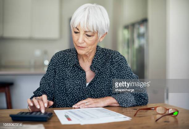 working it all out - pension stock pictures, royalty-free photos & images
