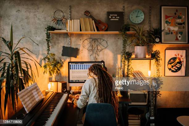 working late hours to finish a song - composer stock pictures, royalty-free photos & images