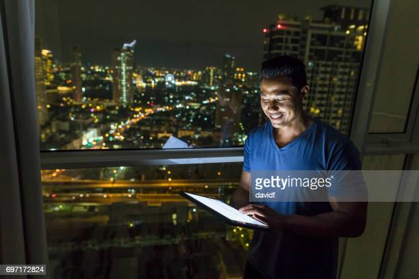 Working Late in A High Rise Building With Tablet Computer