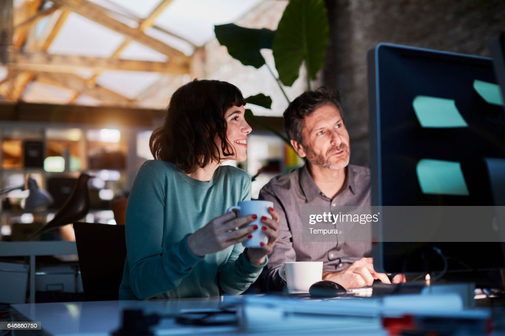Working late in a small office in Barcelona : Stock Photo