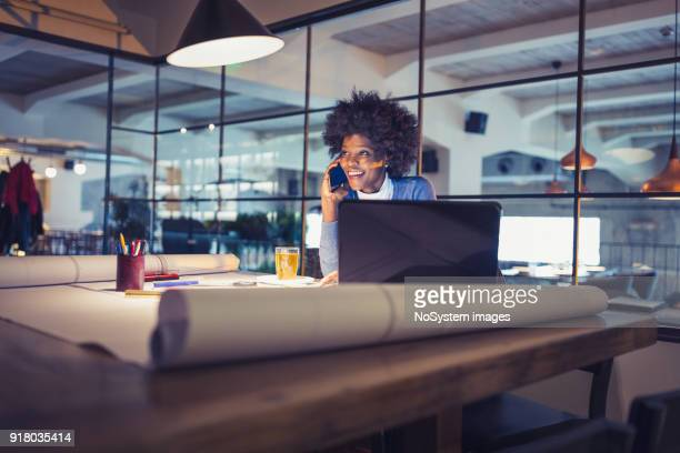 working late. young woman, architect working late in office - architect stock pictures, royalty-free photos & images