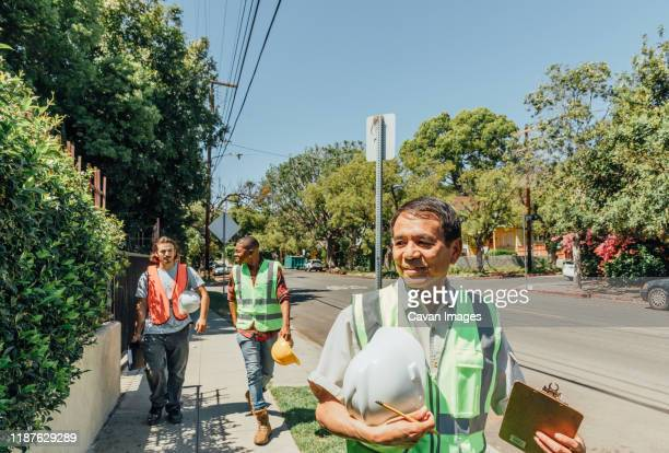 working men leave for the day - local politics stock pictures, royalty-free photos & images