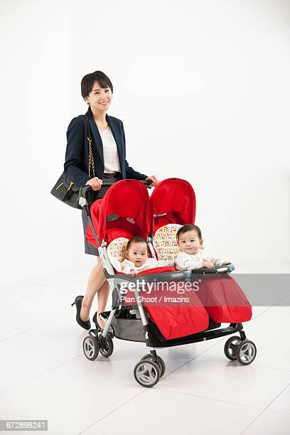 Working Mom put the twins in the stroller