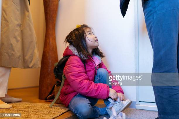 working mother and daughters getting ready to leave house - school girl shoes stock pictures, royalty-free photos & images