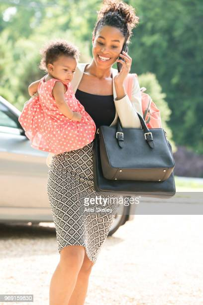 Working Mother and Infant on Cell Phone