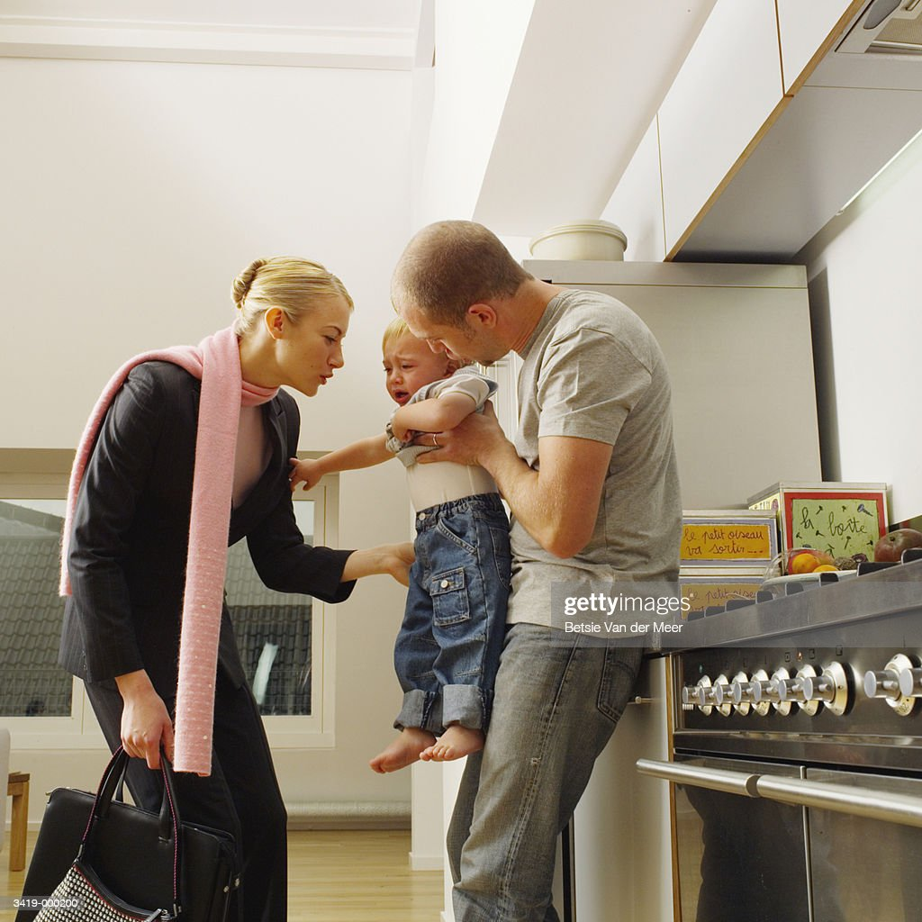 Working Mother Leaving Baby : Stock Photo