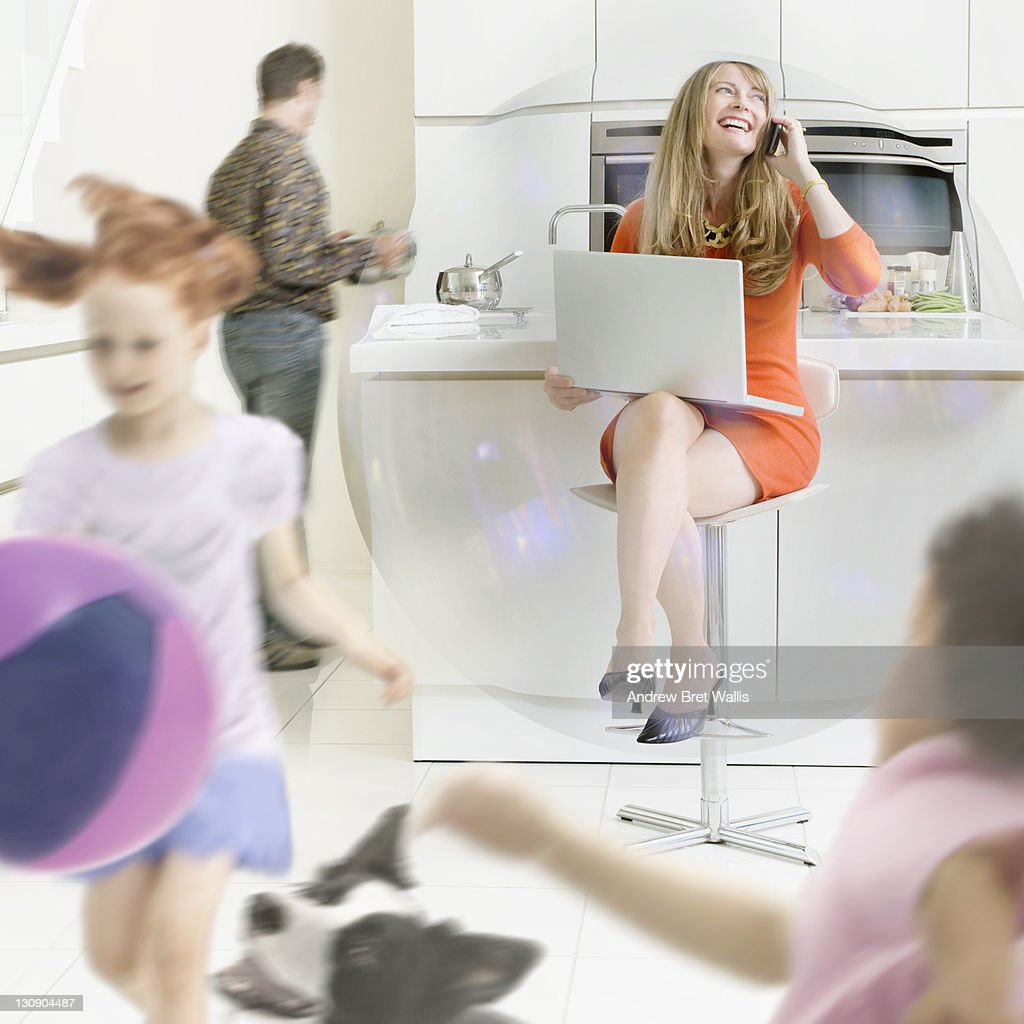 Working mum in a bubble in a busy family home : Bildbanksbilder
