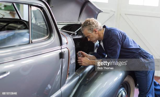 working on a classic car - vintage auto repair stock pictures, royalty-free photos & images