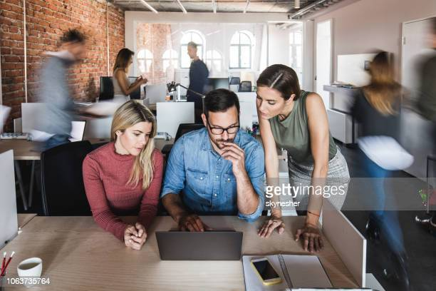 working on a computer at busy office! - graphic designer stock pictures, royalty-free photos & images