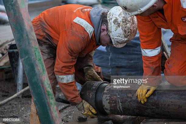 Working on a pipe used for a borehole construction site