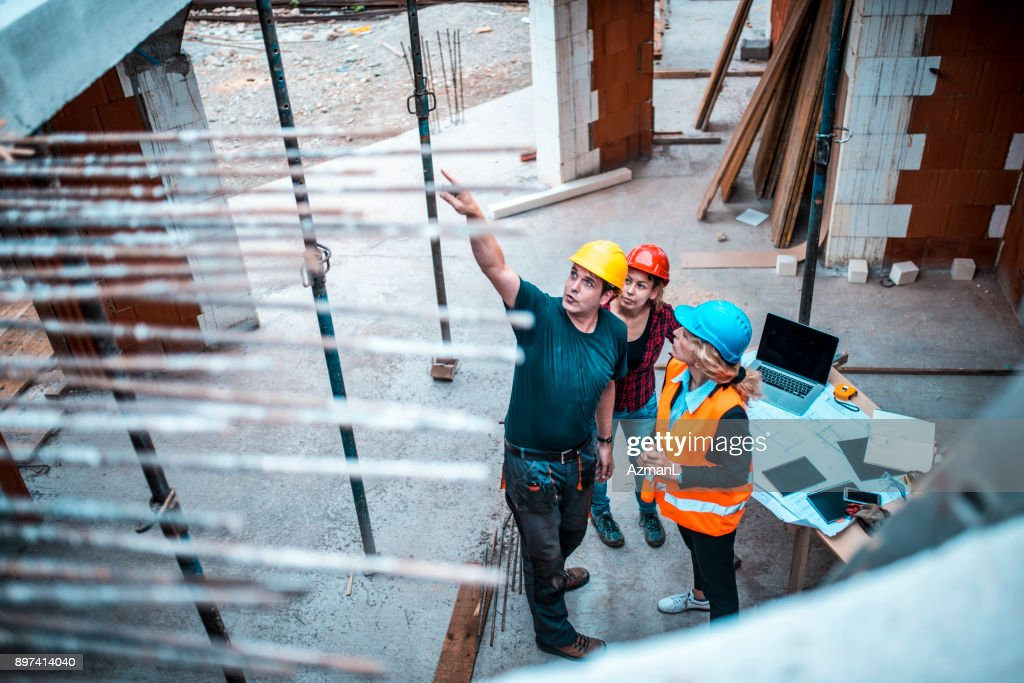 Working on construction site : Stock Photo