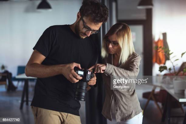 working on creative things - pointing at camera stock photos and pictures