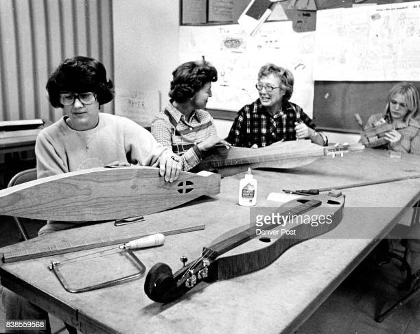 Working on dulcimers, from left to right, are Jean Titus, Delores Mohr, Margaret Bradley, Robin Fjone. Instruments are made of mahogany or walnut;...