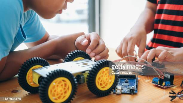 working on handmade car model, construction on electronic. - remote controlled car stock pictures, royalty-free photos & images
